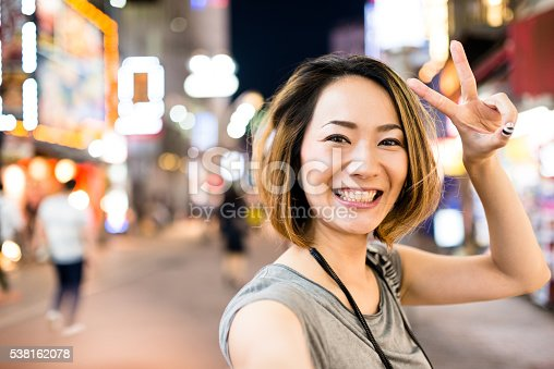 istock pensive japanese woman on the phone 538162078