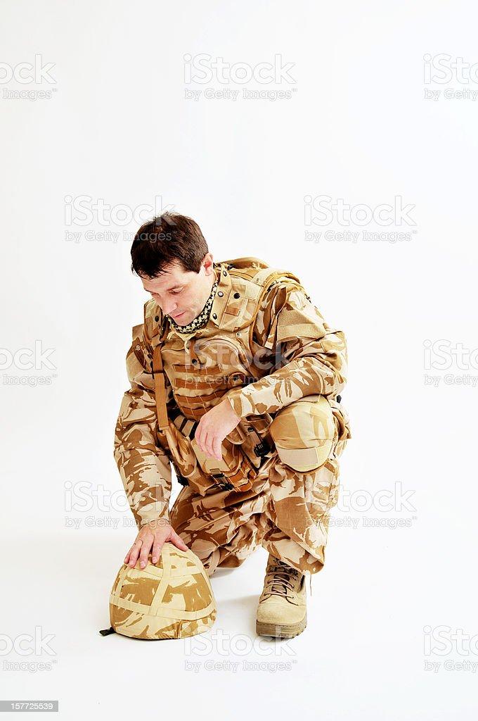 Pensive Kneeling Soldier stock photo