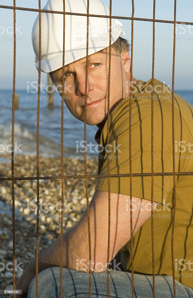 Pensive looking construction worker. royalty-free stock photo