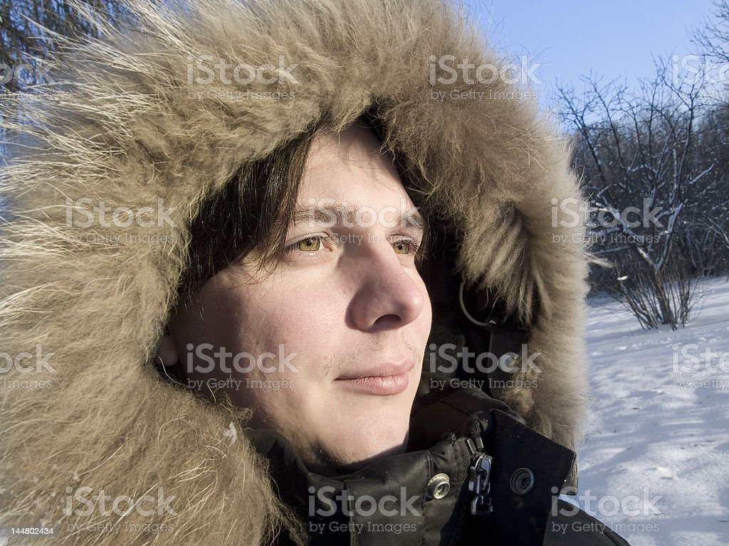 pensive man in winter forest royalty-free stock photo