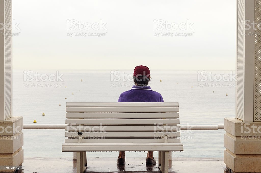 Pensive Man on a Bench Looking Sea.Copy Space. royalty-free stock photo
