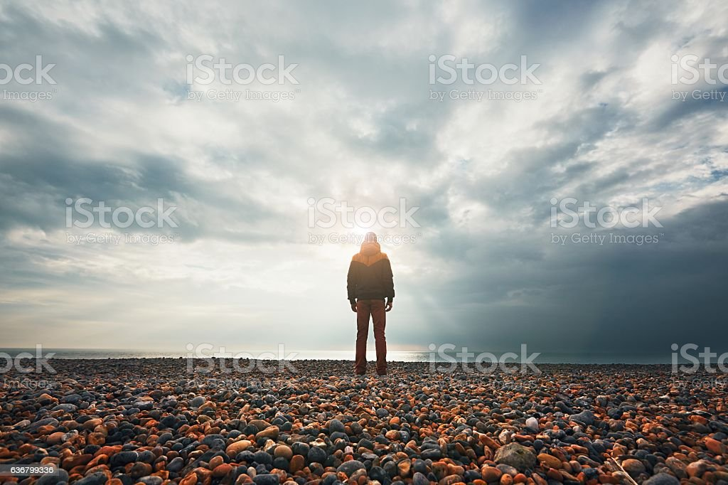 Pensive man on the beach stock photo