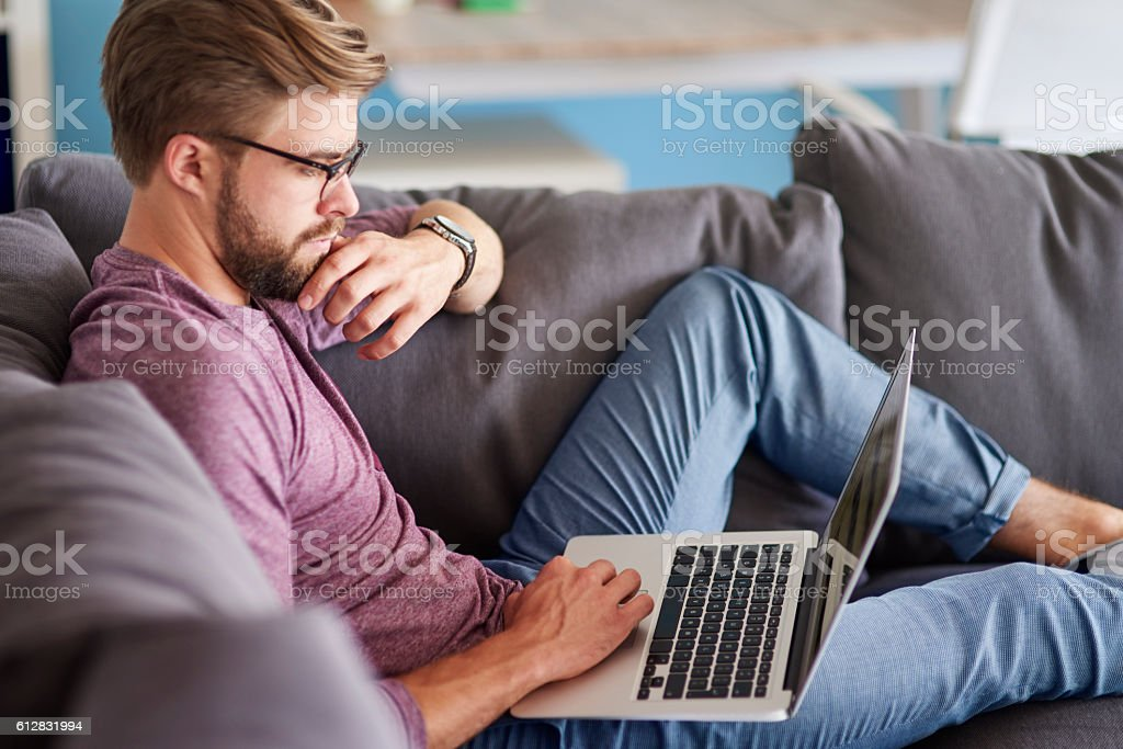 Pensive man working at home – Foto