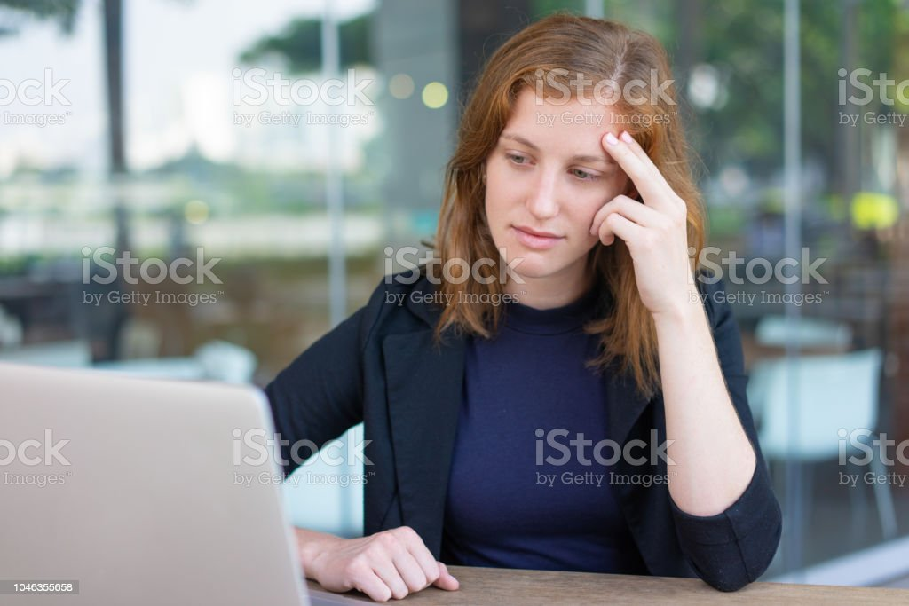 Pensive manager watching movie during work break stock photo