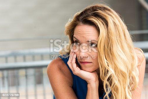 istock Pensive Mature blond woman 623779788