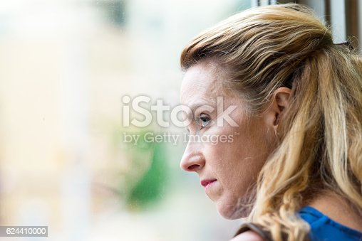 istock Pensive Mature blond woman 624410000