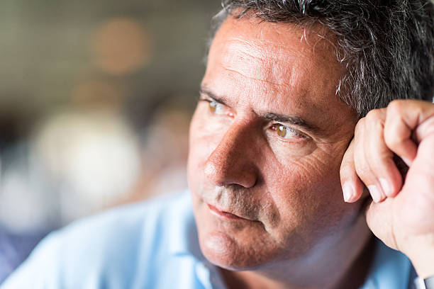 Pensive mature man Pensive mature man looking away erectile dysfunction stock pictures, royalty-free photos & images