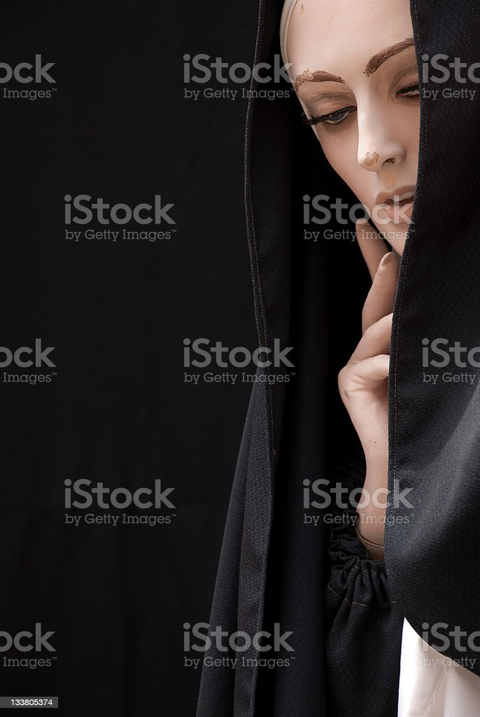 Pensive Nun Over Black Background royalty-free stock photo