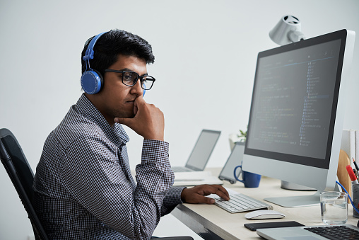 Pensive Programmer Stock Photo - Download Image Now