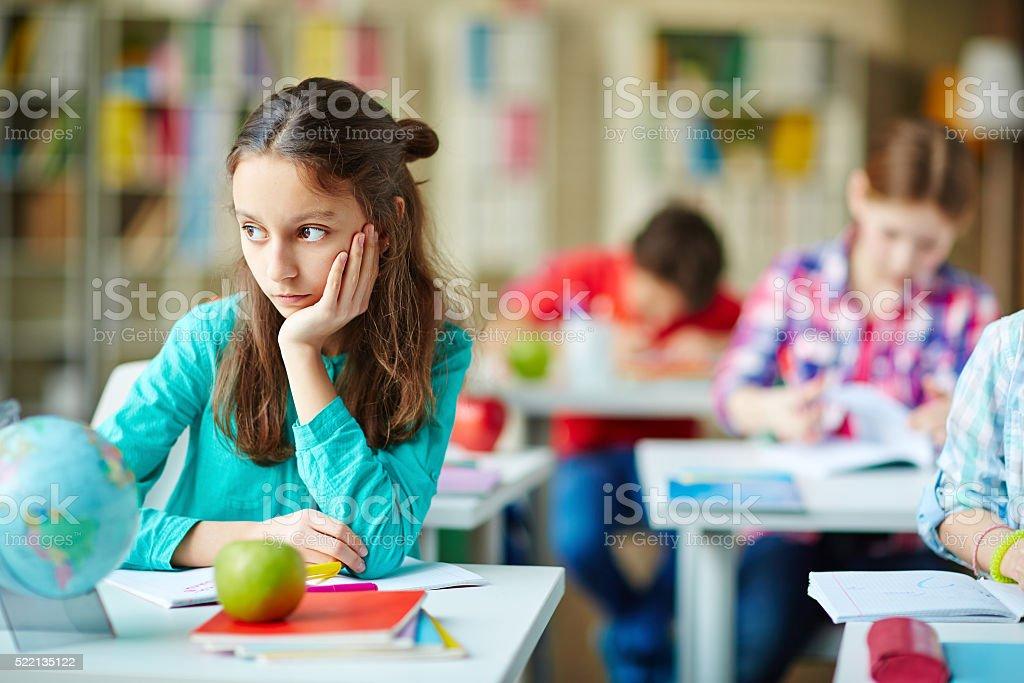 Pensive schoolgirl stock photo