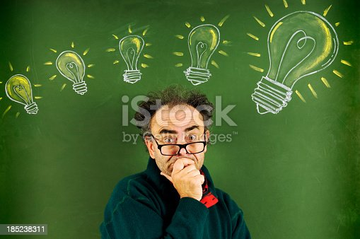 istock Pensive Scientist and Big Ideas 185238311