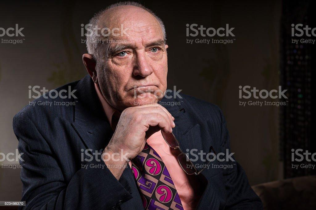 Pensive Senior Businessman Looking Into Distance stock photo