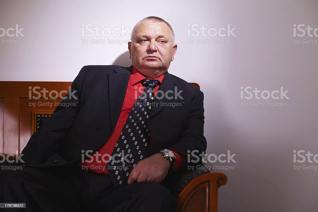 Pensive senior businessman stock photo