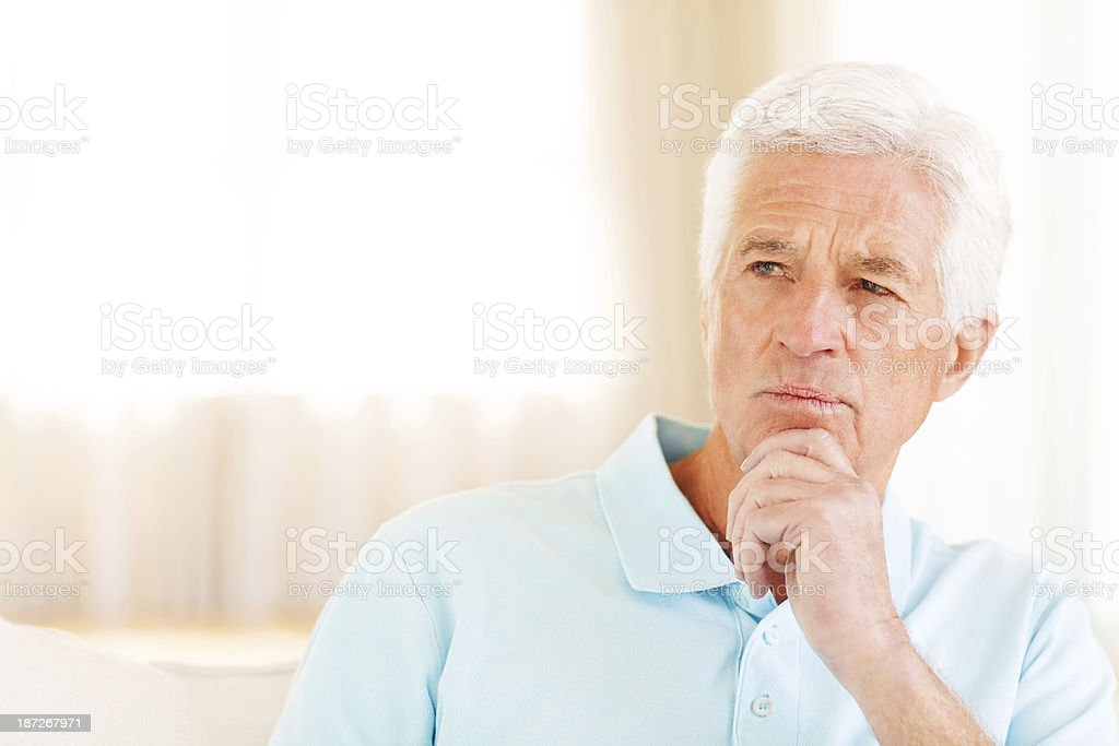 Pensive Senior Man At Home royalty-free stock photo