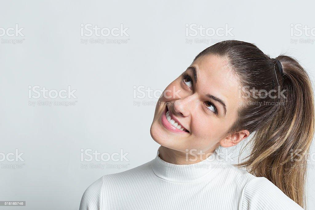 Pensive smiling girl stock photo