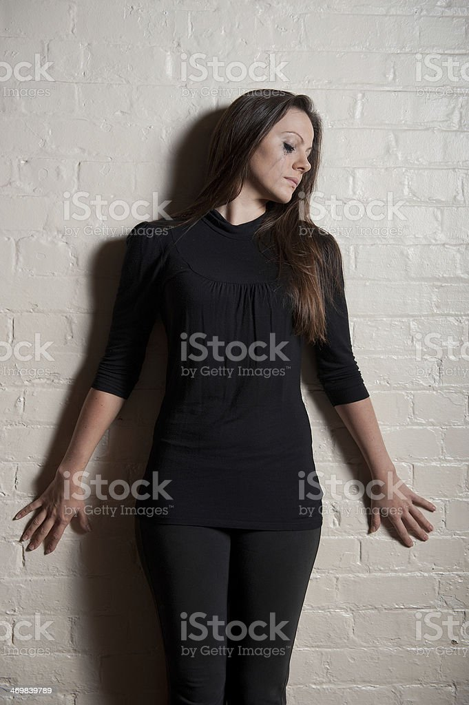 Pensive & Tearful Young Woman stock photo
