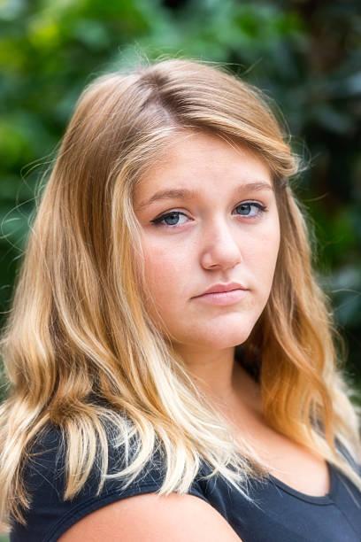 ... Pensive teenage girl stock photo ...