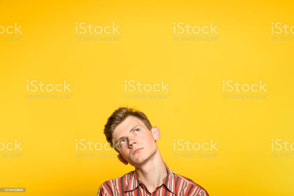 pensive thoughtful contemplative man look up stock photo