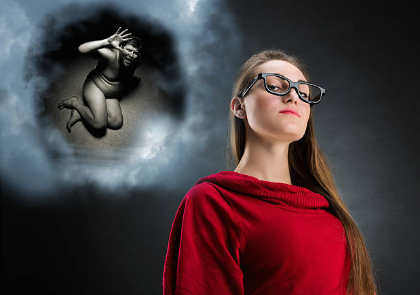 Pensive woman and cloud with her thoughts stock photo