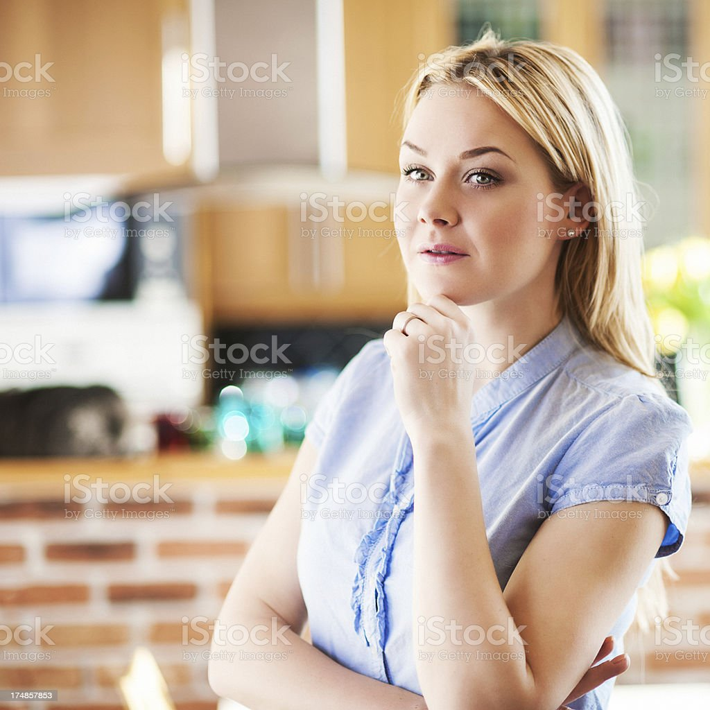 Pensive woman in kitchen royalty-free stock photo