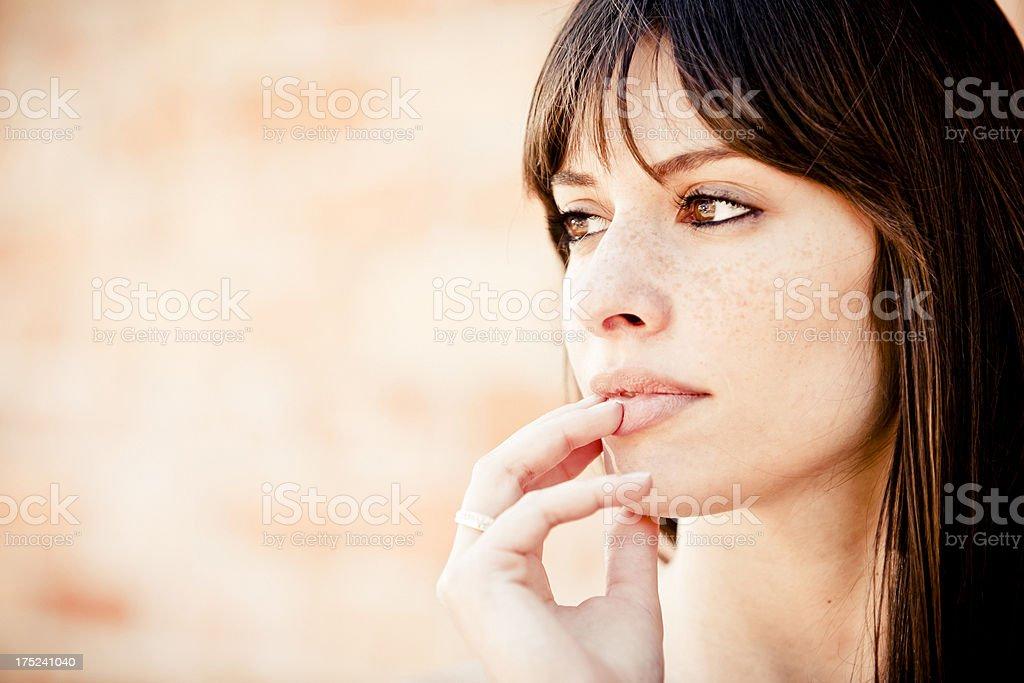 Pensive woman looking away royalty-free stock photo
