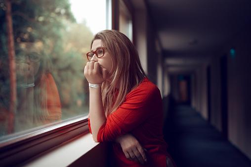 istock pensive woman 1027530562