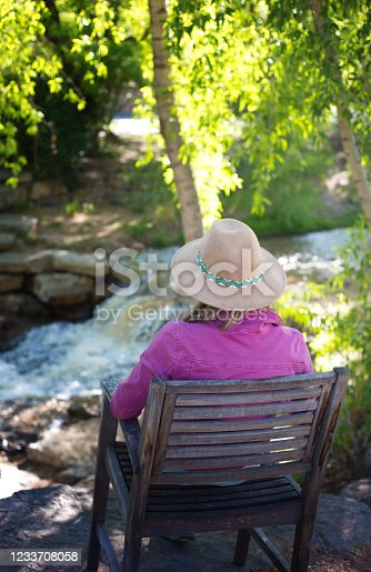 Pensive Woman Sits Alone Waterfall/Stream