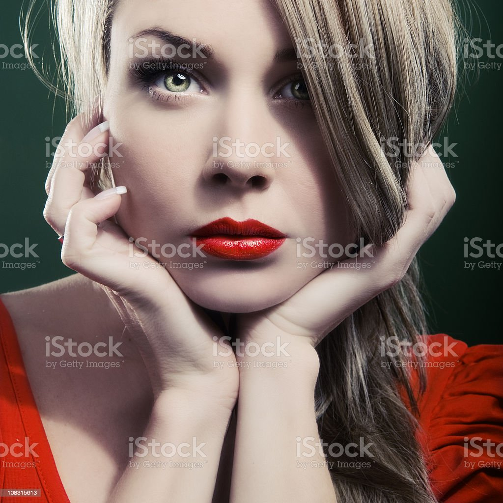 Pensive woman with rich red lips royalty-free stock photo