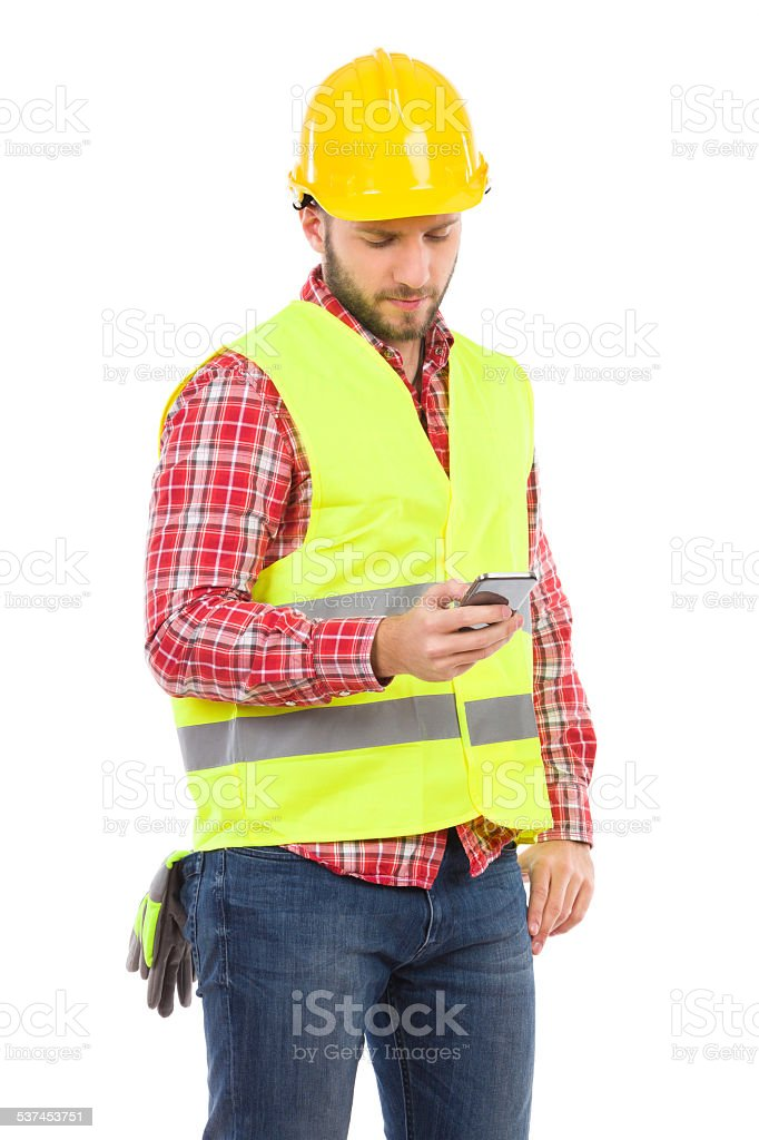 Pensive worker sending a text message stock photo