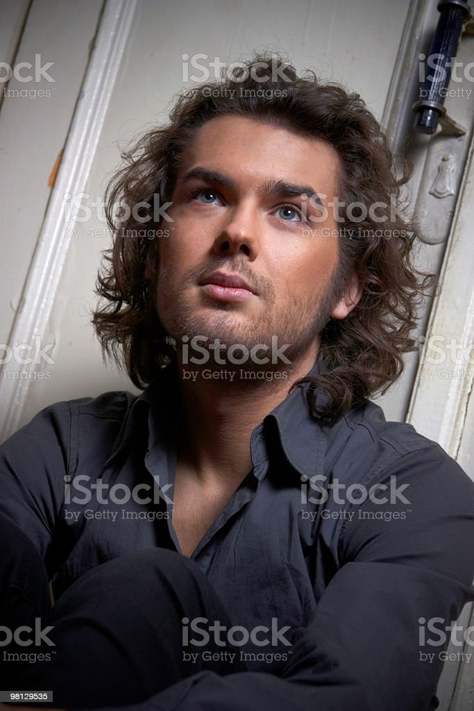 pensive young cute guy looks into the distance royalty-free stock photo