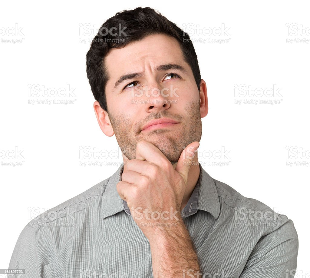 Pensive Young Man, Hand On Chin, Looking Up stock photo