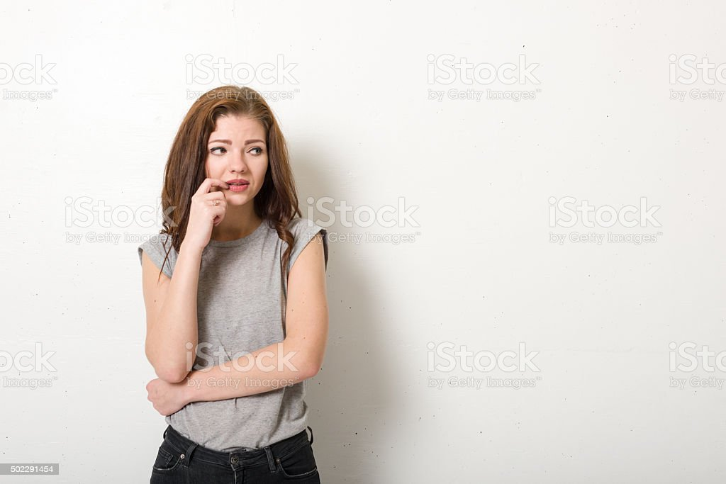 Pensive young woman looking to the side stock photo