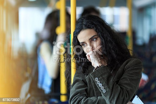 istock Pensive young woman traveling and holding smart phone 673073832