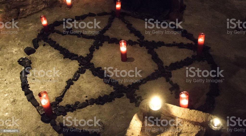Pentacle demon candles stock photo