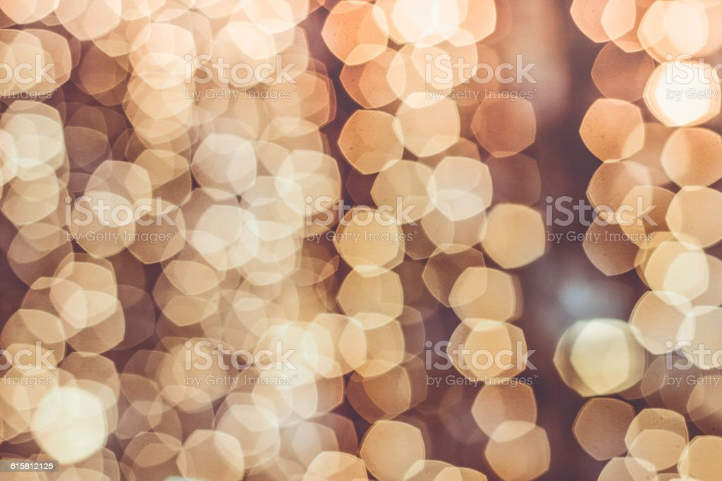 pentagonal bokeh defocused lights abstract background stock photo