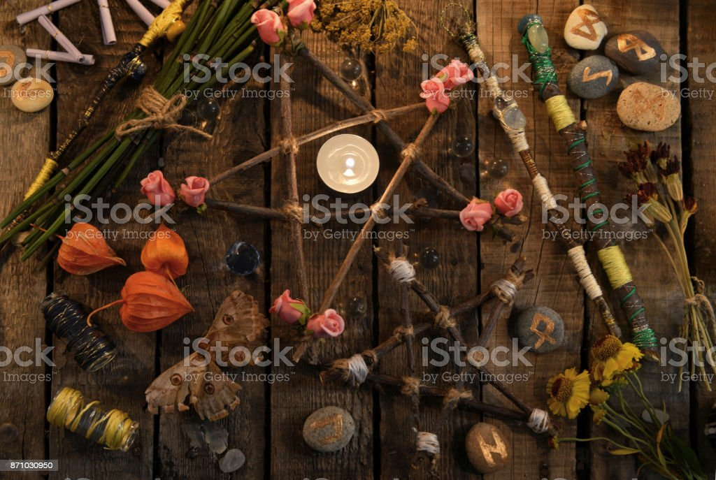 Pentagrams with magic wands, moth, runes and flowers stock photo