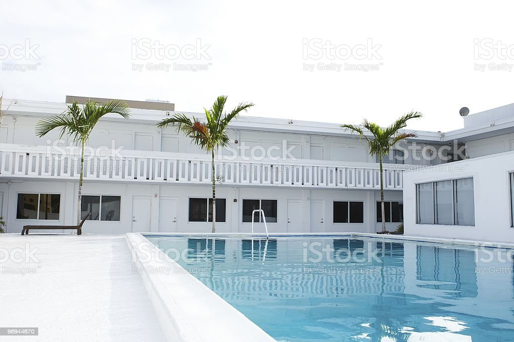 penthouse swimming pool in front of 3 palmtrees royalty-free stock photo