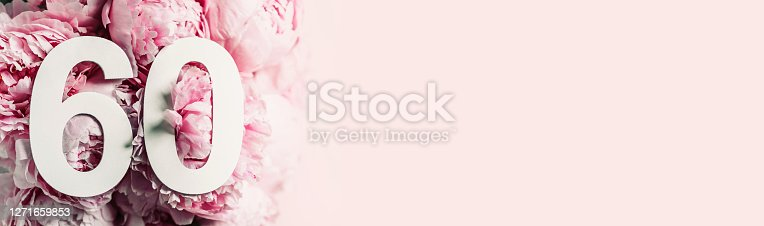 Peony flowers, digit sixty. Birthday greeting card with inscription 60. Anniversary concept. Top view. White numeral on flower background. Numerical digit, Celebration event, template, flyer.