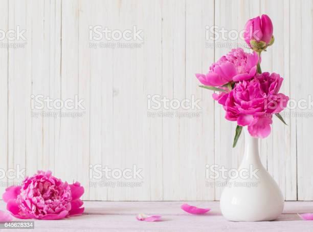 Peony flowers in a vase on a white wooden background picture id645628334?b=1&k=6&m=645628334&s=612x612&h=r2et7oijzq2hyxioxvkkl6lmvqp8qgu2sufnwyrpkbc=