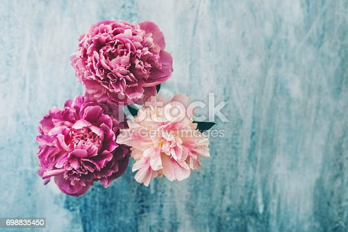 Peony flowers on rustic background