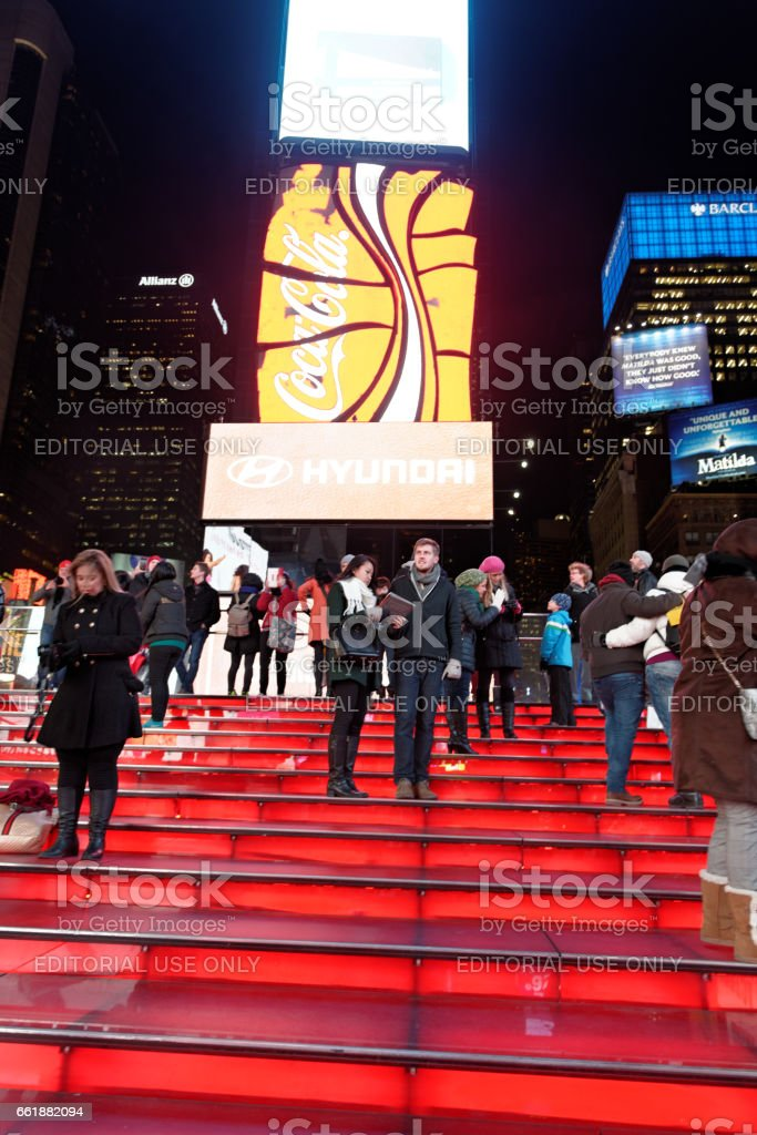 Peope on red steps at Times Square New York City,USA stock photo