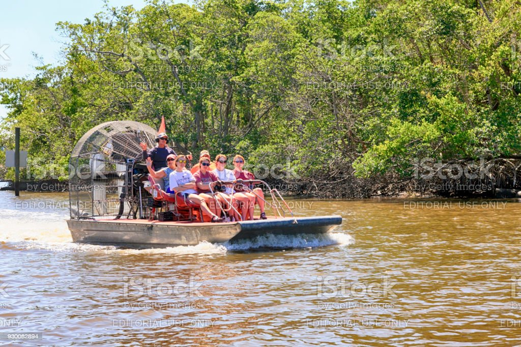 People aboard airboats heading out on a tour of the mangrove swamps in the Everglades in Florida USA stock photo