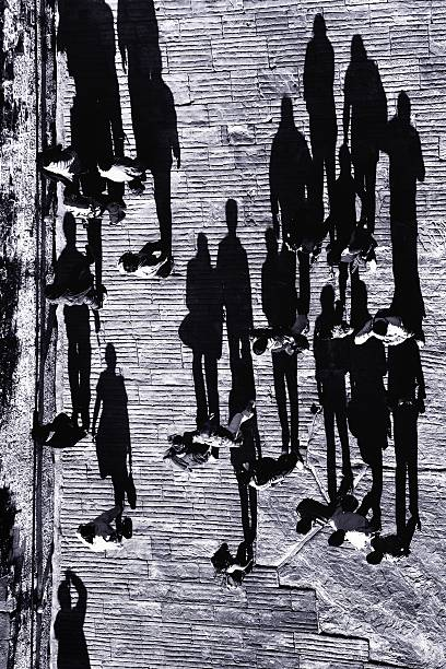 People against  a shadow stock photo