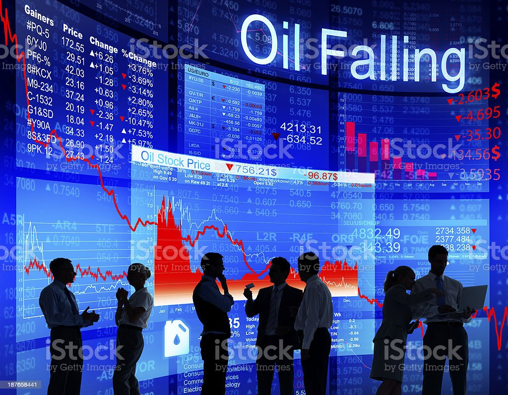 People against screens of bar graphs show falling oil price royalty-free stock photo