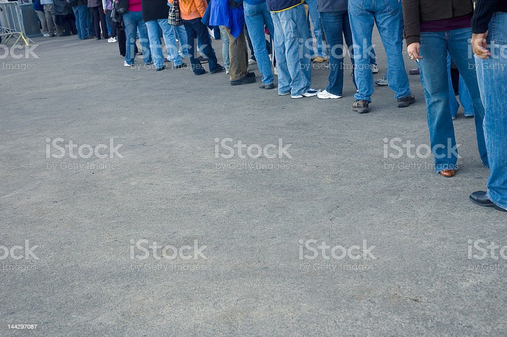 People all wearing jeans waiting in line royalty-free stock photo