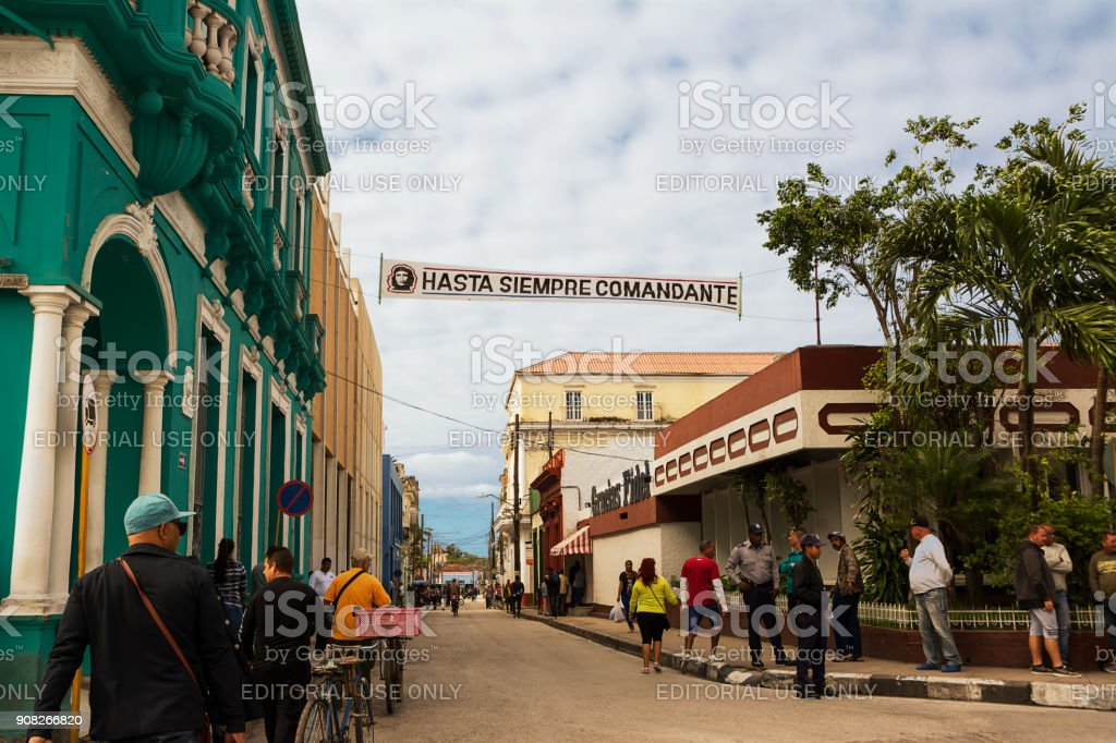 people along a street of Santa Clara with a banner showing the icon of Che and the words 'Hasta siempre comandante' (Until always commander) stock photo