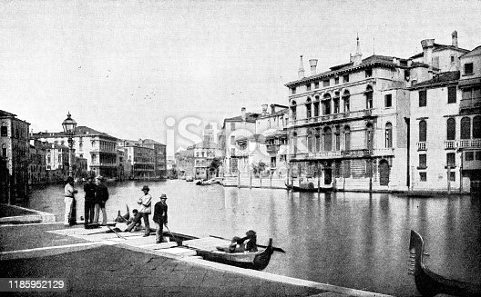 People along the Grand Canal in Venice, Italy. Vintage halftone photo circa late 19th century.