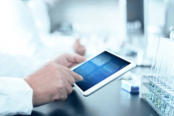people analysis chemical experiment by tablet in modern lab - medical research stock photos and pictures