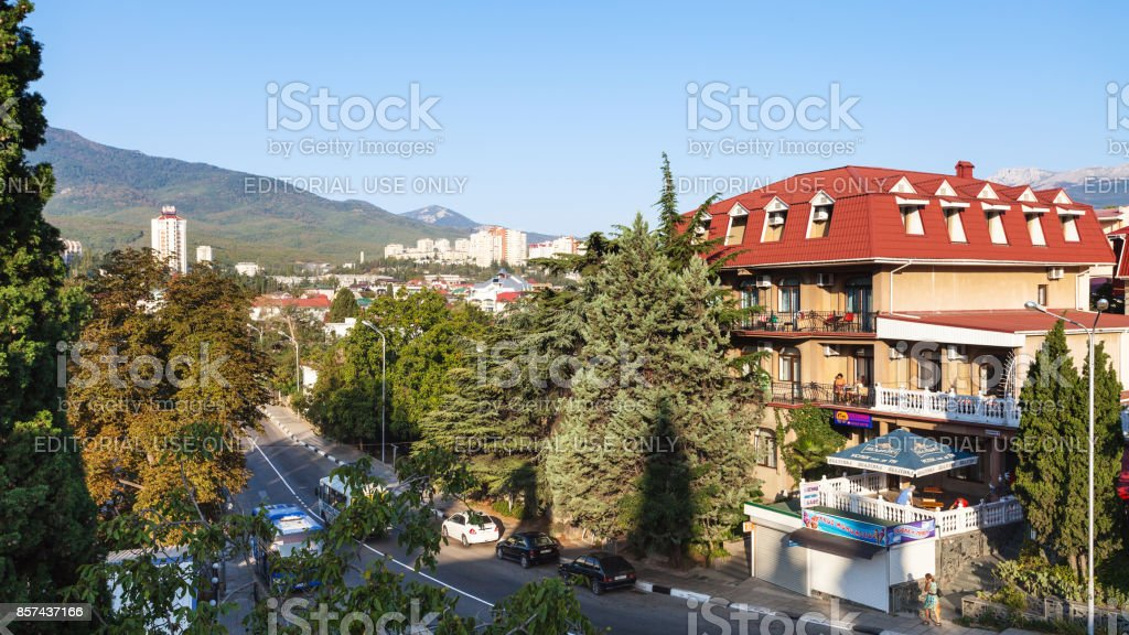 people and apartment houses in Alushta city stock photo
