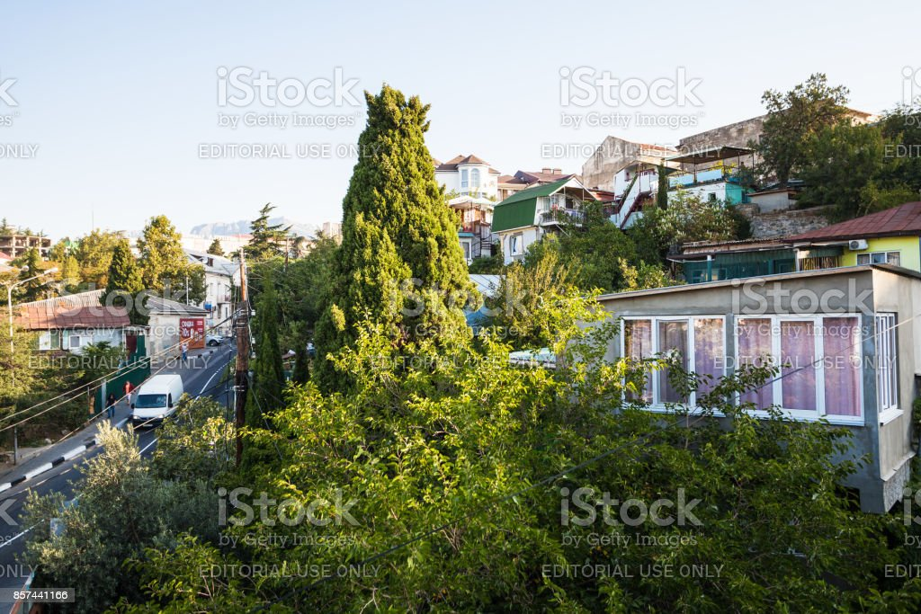 people and apartment on Baglikov Street in Alushta stock photo